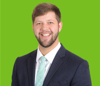 Male SERVPRO Owner on green background