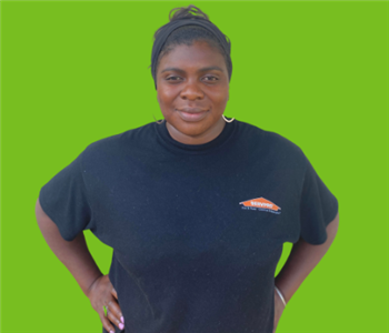 Female SERVPRO employee on green background