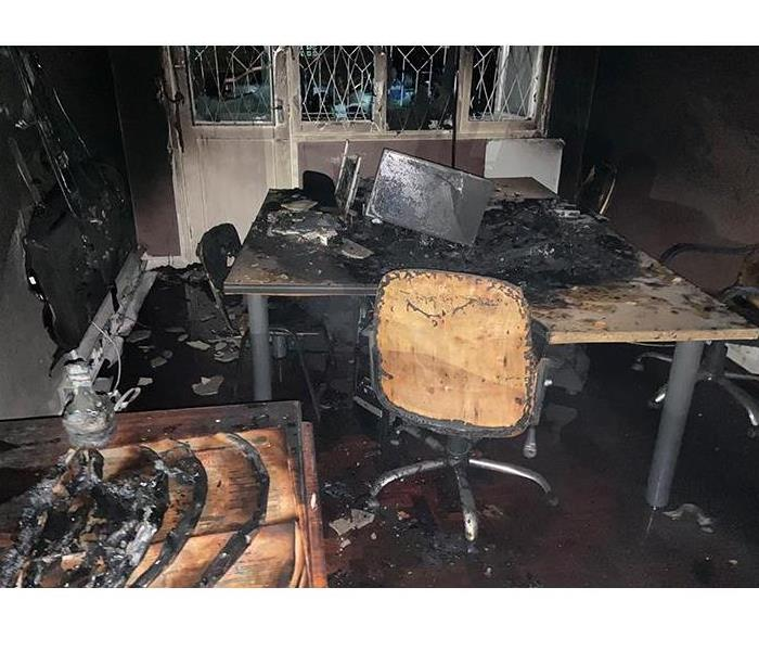 office covered in soot damage from fire