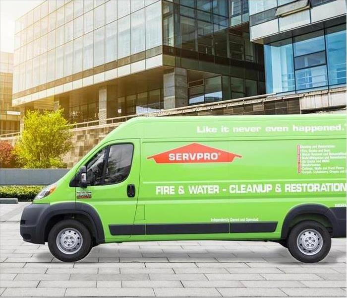 SERVPRO van in sun next to building